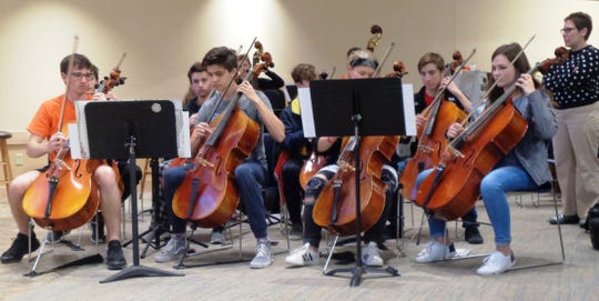 Loveland High School cello group with orchestra director Rachel Bierkan during rehearsal with Break of Reality at Prince of Peace church in Loveland.