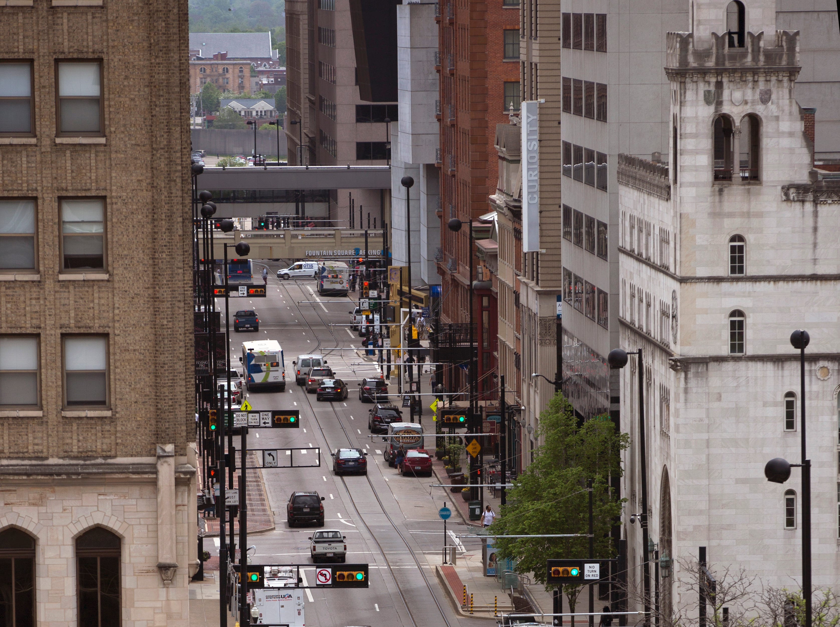 A view looking south down Walnut Street in downtown Cincinnati. Walnut is on the Cincinnati Bell Connector route and is heavily travelled by the Metro Buses. Government Square is at Walnut and Fifth Street. Photographed May 1, 2019.