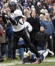 Cincinnati wide receiver Armon Binns (80) catches the game winning touchdown against Pittsburgh DB Jovani Chappel (7) in the 4th quarter in a NCAA college football game in Pittsburgh, Pennsylvania Saturday December 5, 2009 at Heinz Field. Cincinnati won 45 to 44 over Pittsburgh.