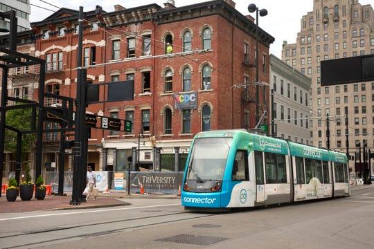 The Cincinnati Bell Connector makes its way down Walnut Street in downtown Cincinnati.