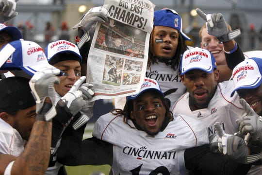 "December 5, 2009: Cincinnati DB Will Saddler (16) holds up a Cincinnati Enquirer newspaper ""Big East Champs"" headline with teammates after beating Pittsburgh in a NCAA college football game in Pittsburgh, Pennsylvania Saturday December 5, 2009 at Heinz Field. Cincinnati won 45 to 44 over Pittsburgh."