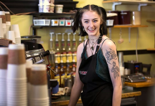 Cheyenne McKinney is the barista at Kitty's Coffee on Court Street near the Hamilton County Courthouse in downtown Cincinnati. Gary Gabbard and his wife, Kitty Syphax, have owned the local coffee shop for 13 years, but he's not sure how much longer he'll be able to stay afloat. He took a hit when Dunkin' Donuts opened next door and now the new 18-story Kroger development will bring more challenges. The grocery story, that will include a food court, should open in the fall. Photographed May 6, 2019.