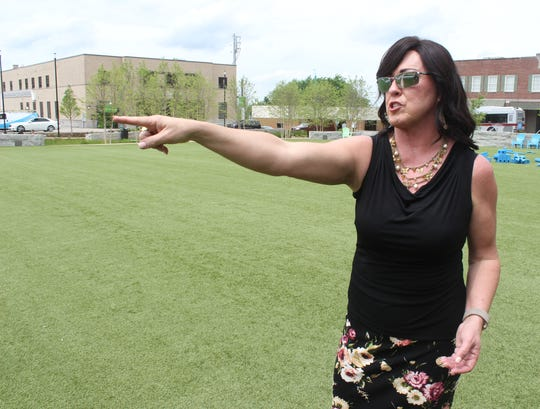 Clarksville resident Tina Young discusses  what went wrong at the Seafood and Beer Festival held at Downtown Commons in Clarksville on April 27, 2019.