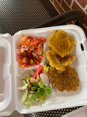 A $15 platter offered to ticket-holders at the Seafood and Beer Festival included fried plantains, salad with no dressing and shrimp salsa that was light on shrimp.