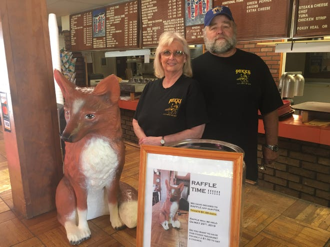 Foxx's Sub Shoppe owners Bob and Mary Beth Hand are closing their restaurant May 25. The signature fox in the foreground will be raffled off on that day.