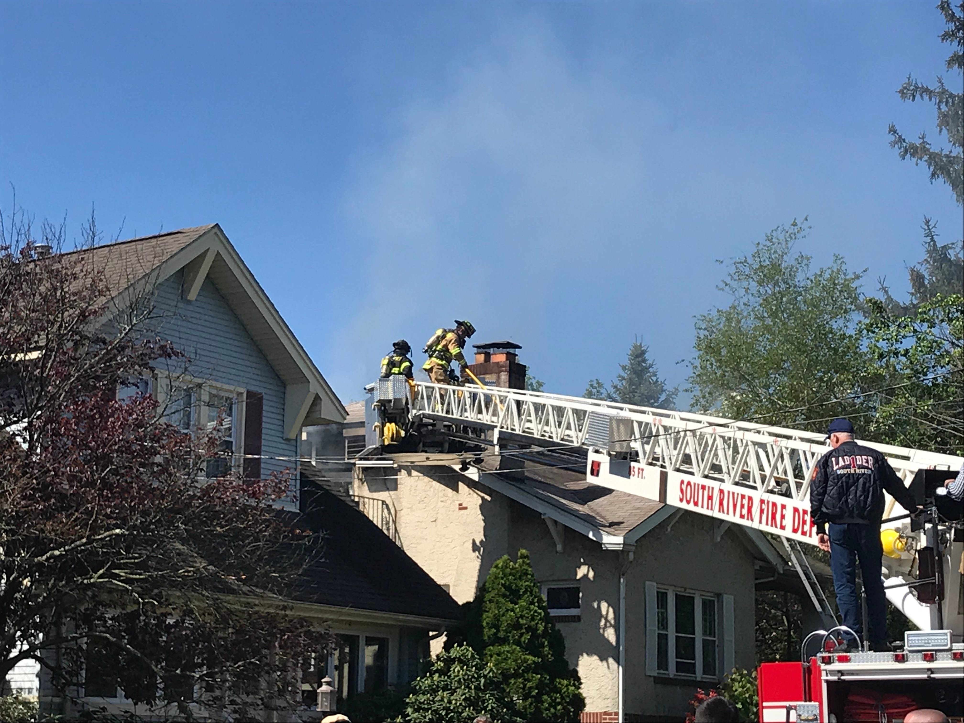 Emergency personnel responded to a fire on Devoe Street in South River on Monday.