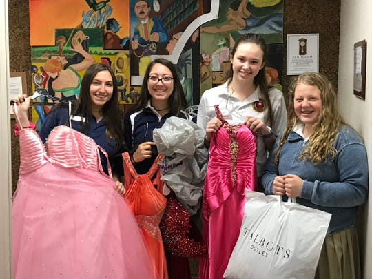 The Peer Ministry Club at Mount Saint Mary Academy in Watchung sponsored a Prom Dress Collection to benefit Catherine's Closet in Newark. Gently-used prom dresses, handbags and accessories were donated by students, parents and other members of the Mount community. Pictured, left to right, are Elizabeth DiGrande (junior from Warren), Nicole Nunez (junior from Raritan), Claire King (freshman from Berkeley Heights), and Lindsey Sieman (freshman from New Providence).