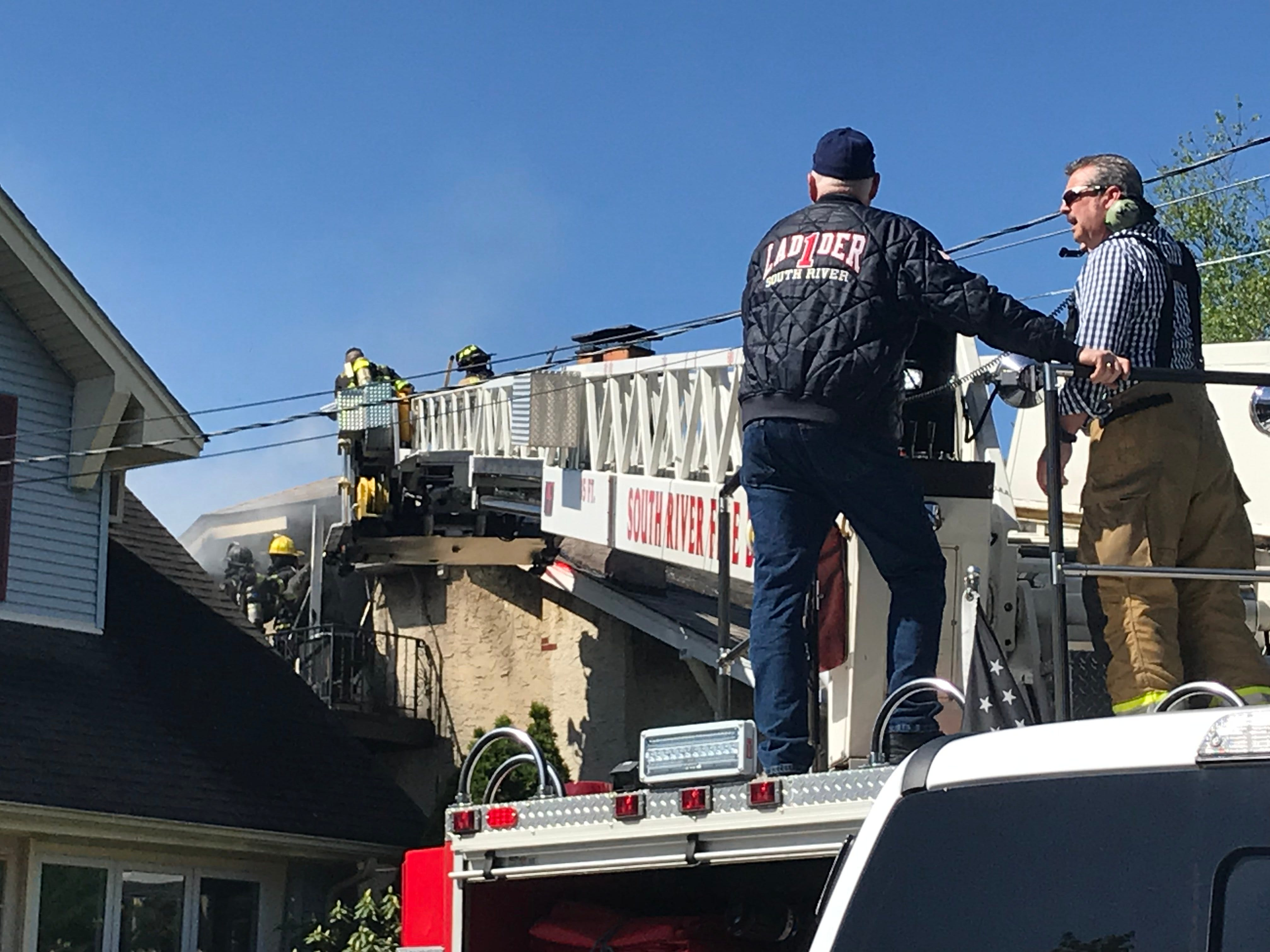 Firefighters battled a fire on Devoe Street in South River Monday morning.