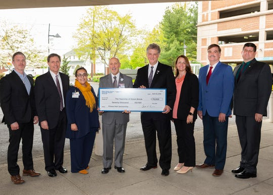 John DiLeo (left to right), vice president of finance, Robert Wood Johnson University Hospital Somerset, Mike DuBois, assistant vice president, business development, Robert Wood Johnson University Hospital Somerset, Sejal Dave Sharma, director, business development, Robert Wood Johnson University Hospital Somerset, Tony Cava, president and chief executive officer, Robert Wood Johnson University Hospital Somerset presents the final check for a fitness court to Patrick Boccio, Green Brook mayor, Kelly Cupit, Green Brook township administrator/municipal clerk, Jerry Searfoss, Green Brook committeeman and Raymond Murray, Green Brook chief financial officer.