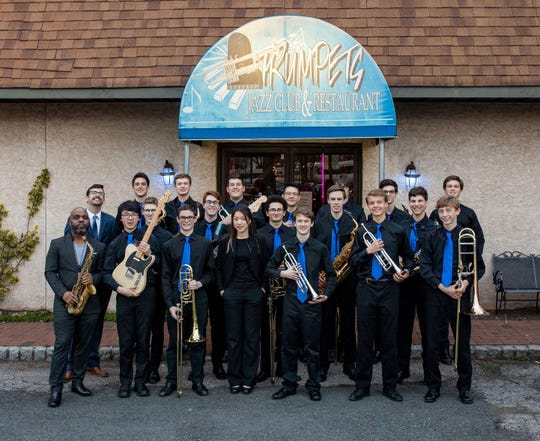 Members of the Westfield High School Jazz Band played alongside world-renowned saxophonist Jaleel Shaw (left front) during a recent performance at the Trumpets Jazz Club in Montclair as part of a jazz education initiative.