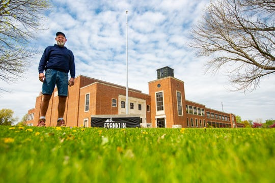 Jeff Young, owner of the Franklin Jr. High building in Des Moines stands for a photo in front of the building Monday, May 6, 2019.