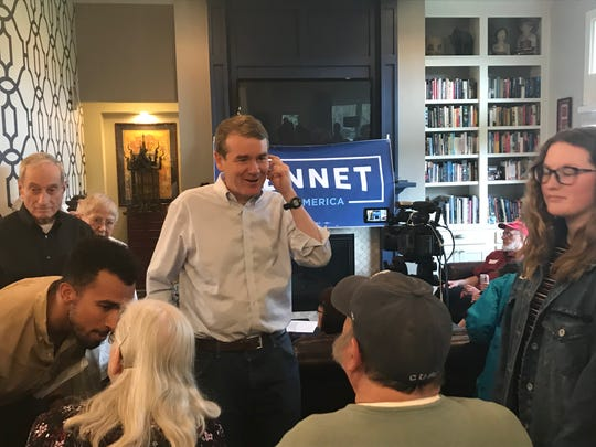 Sen. Michael Bennet, on his first trip to Iowa as an official presidential candidate, talks with Iowans before speaking in Ankeny.