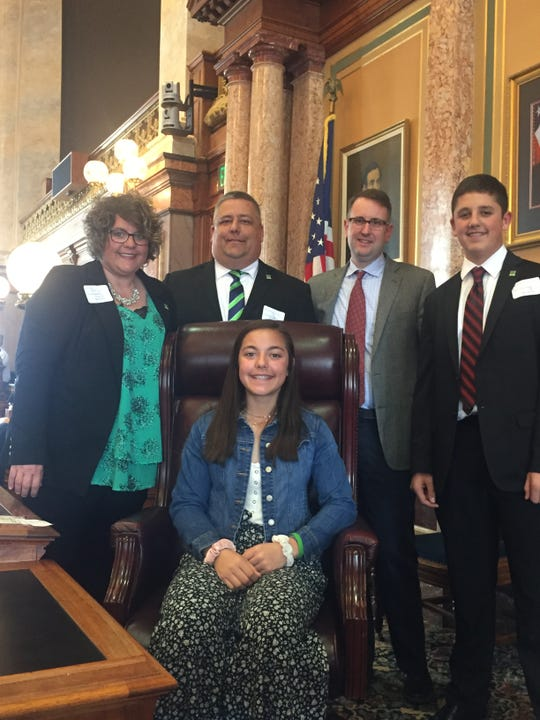 The family of Logan Luft is pictured with House Minority Leader Todd Prichard.  Logan's Law was passed in the final days of the Legislature. It allows for organ and tissue donors to indicate their wishes on their hunting and fishing licenses.