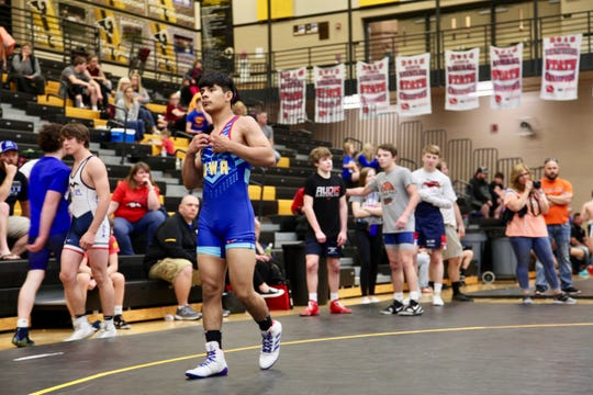 Lisbon's Robert Avila, blue, prepares for a match during the U16 Greco-Roman state championships on Sunday, May 5, at Southeast Polk High School. Avila finished first at 132 pounds.