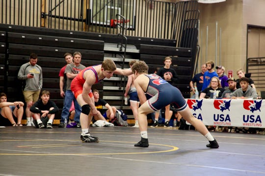 Union's Jack Thomsen, red, wrestles Underwood's Blake Thomsen in the finals of the Junior freestyle state wrestling tournament on Saturday, May 4, at Southeast Polk High School. Jack Thomsen won, 11-6.
