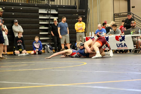 Southeast Polk's Gabe Christenson, in the red, wrestles Creston's Jackson Kinsella in the finals of the Junior freestyle state tournament on Saturday, May 4, at Southeast Polk High School. Christenson won, 10-0.