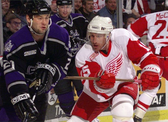 Detroit Red Wings forward (15) Pat Verbeek tries to hold up  the  Los Angeles Kings (21) Bryan Smolinski during their game at Joe Louis Arena in Detroit on Feb 18, 2000.