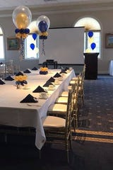 Blue and gold balloons add festive feel to a banquet hall for a school, dance club event at Cherry Creek Golf Club in Shelby Township
