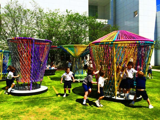 """""""Los Trompos"""" is an interactive art exhibit designed to encourage and bring people together."""