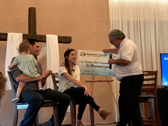 Detroit Tigers pitcher Matthew Boyd, left, and his wife, Ashley, speak with Pastor Paul Edwards of Redeemer Church in Waterford on Sunday, May 5, 2019.