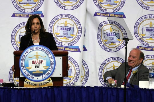 U.S. Sen. Kamala Harris addresses the 64th NAACP Fight for Freedom Fund dinner Sunday  at Cobo Center as Detroit Mayor Mike Duggan listens at right.