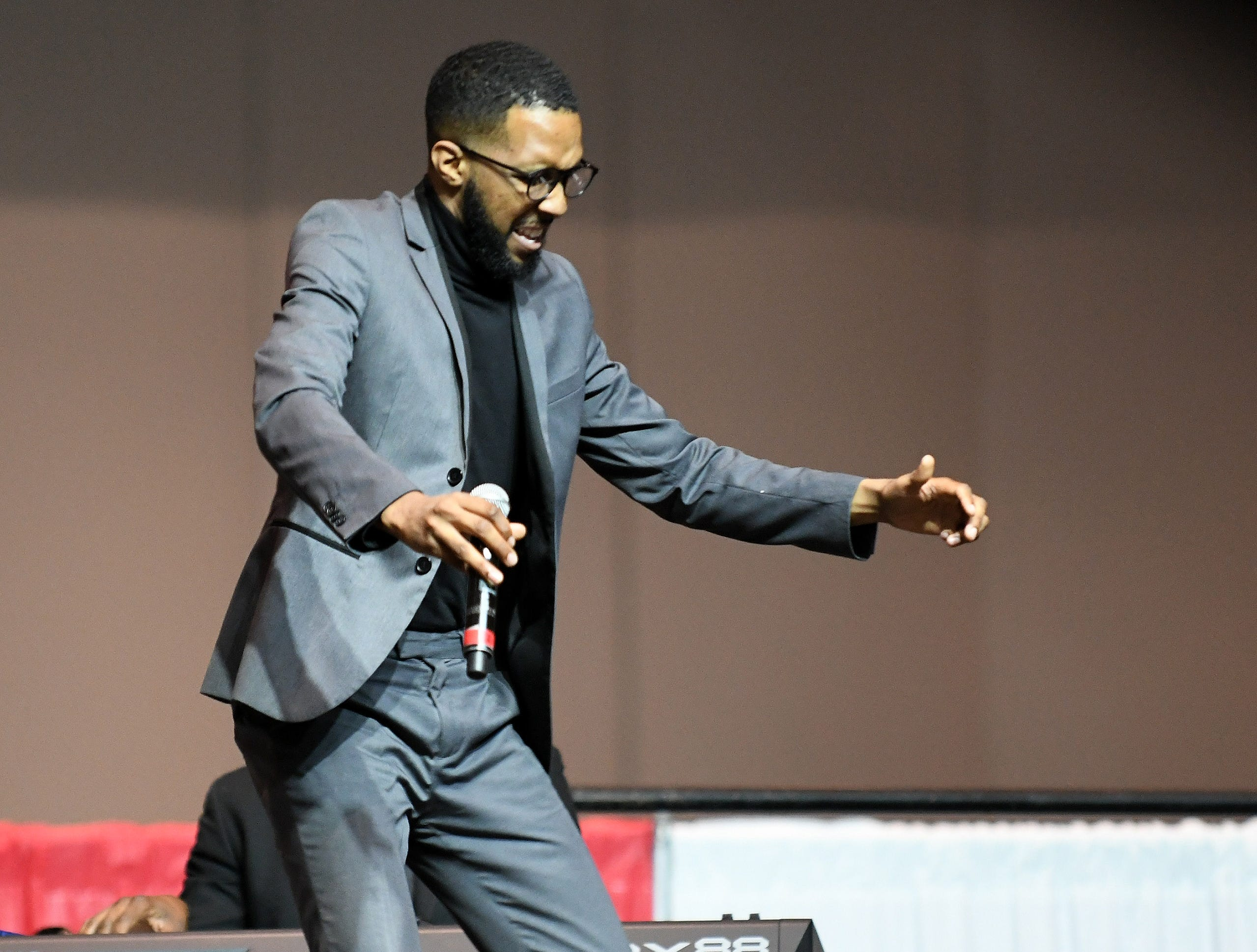 """Justin Crutchfield tap dances during a Detroit school youth choir singing a special version of """"Lift Every Voice and Sing"""", celebrating its 100 years, at the NAACP 64th Annual Fight For Freedom Fund Dinner."""