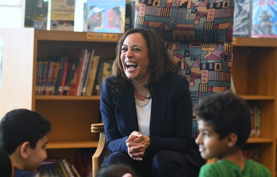 U.S. Senator Kamala Harris laughs while  reads visiting with fourth graders at Miller Elementary School in Dearborn.