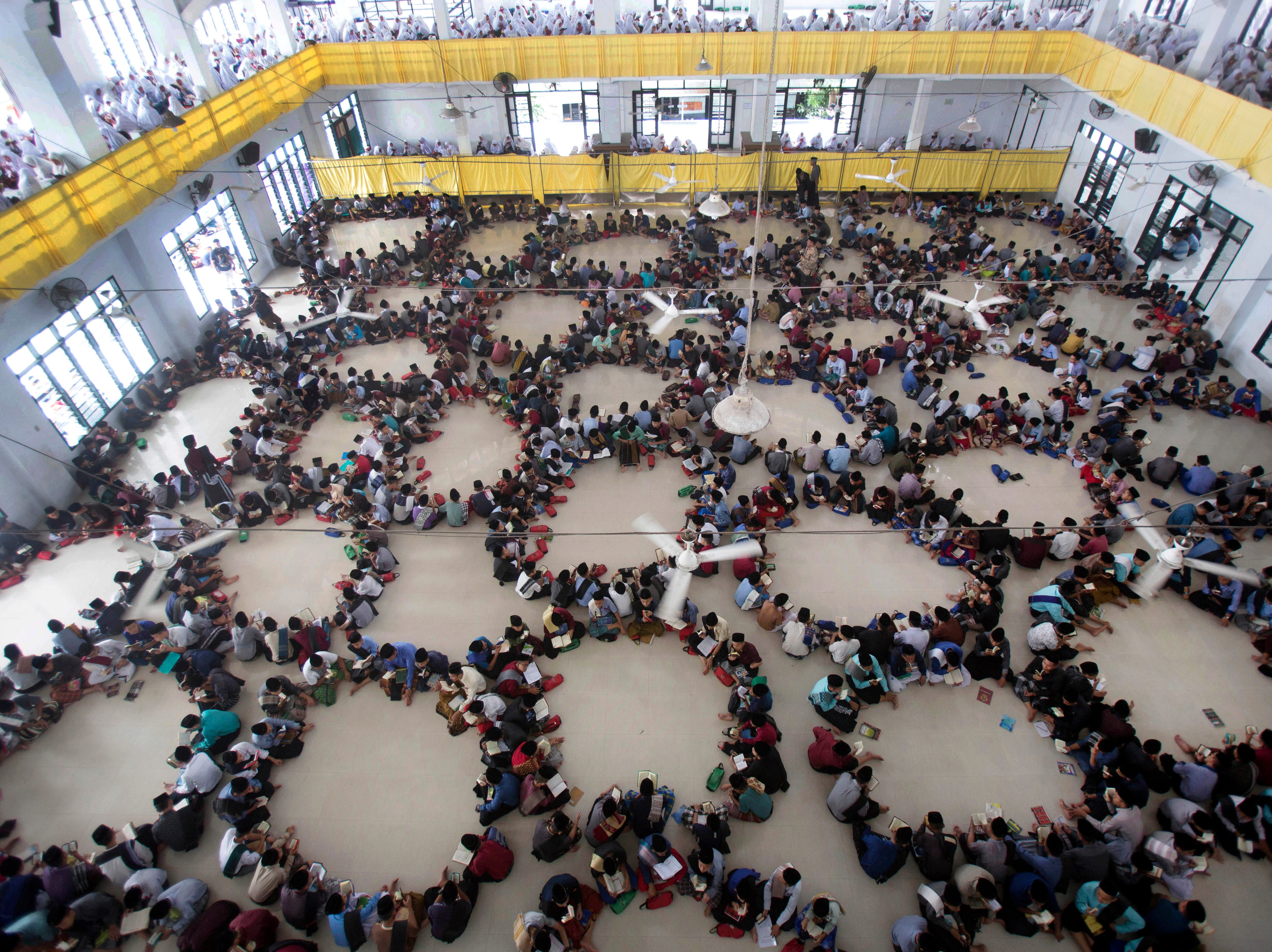 Students sit in circles as they attend a Quran recital class during the first day of the holy fasting month of Ramadan at Ar-Raudlatul Hasanah Islamic Boarding School in Medan, North Sumatra, Indonesia, Monday, May 6, 2019. Muslims around the world marked the start of Ramadan on Monday, a month of intense prayer, dawn-to-dusk fasting and nightly feasts.