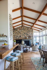 The architecture of the main room and fieldstone fireplace by Ken Richmond of Traverse City's Richmond Architects is a nod to modest beach houses of the 1950s.