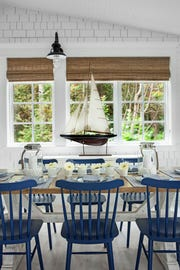 The Cottage Company's Kelly Konoske chose a classic blue and white palette in this casual dining area in Harbor Springs.
