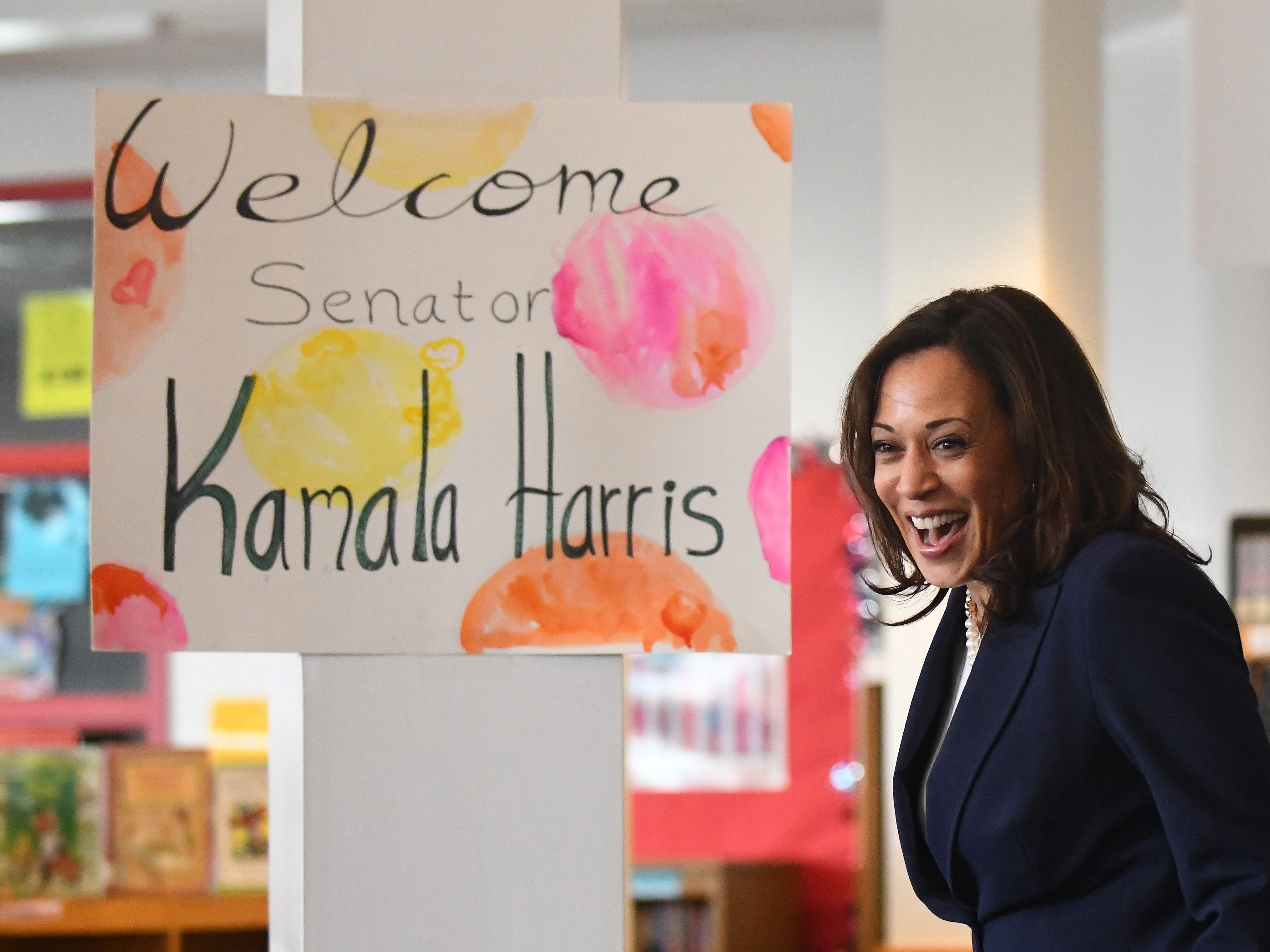 Democratic presidential candidate U.S. Senator Kamala Harris arrives to applause during a visit to Miller Elementary students, reading a story and answerint questions of the 4th graders in Dearborn, Michigan on May 6, 2019.