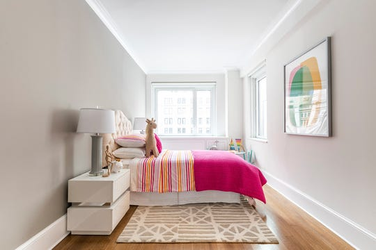 A children's bedroom refreshed through the addition of bright bedding and artwork. (Design Recipes/TNS)