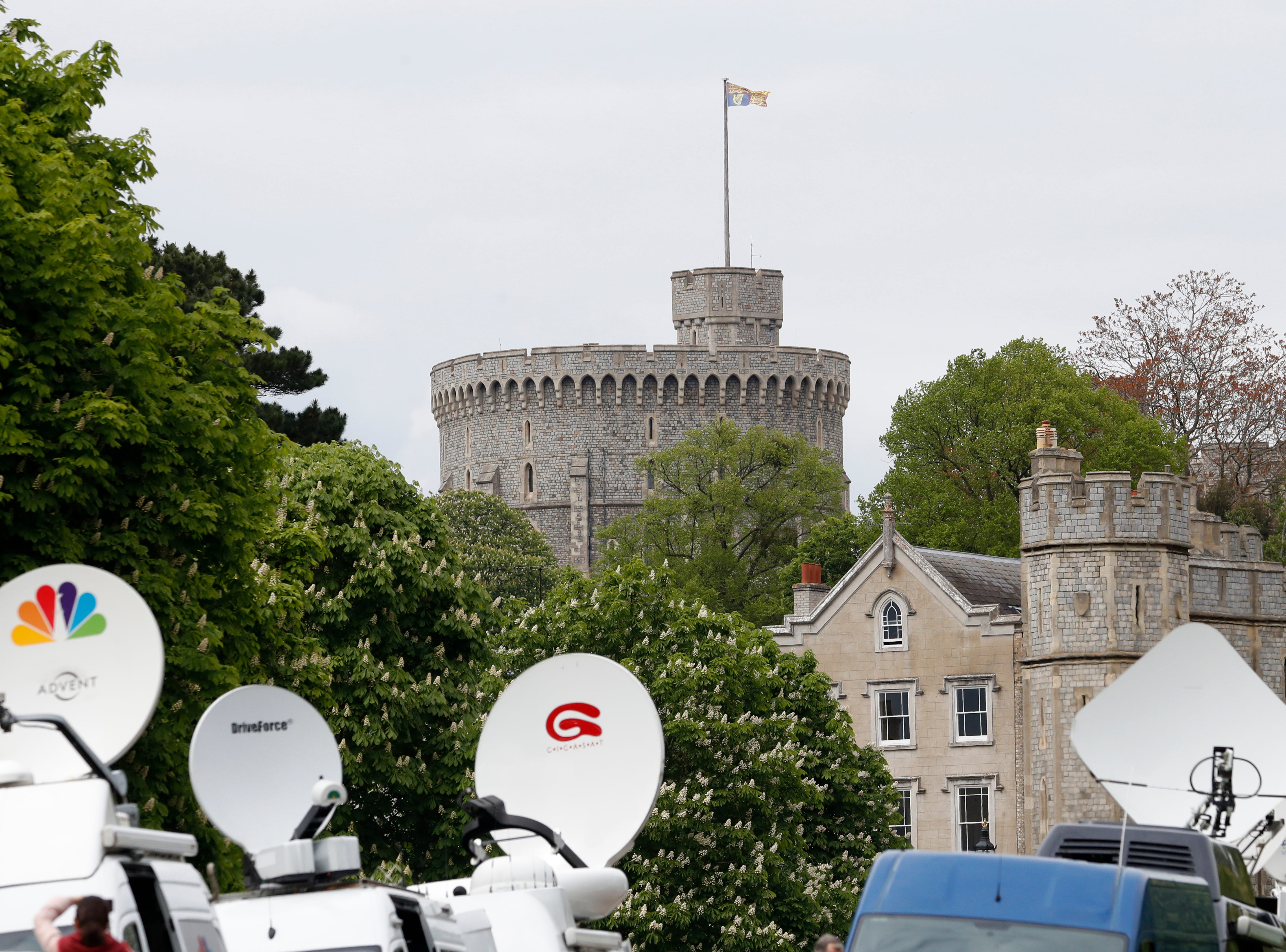 Members of the media gather outside Windsor Castle after Prince Harry announced that his wife Meghan, Duchess of Sussex, had given birth to a boy.