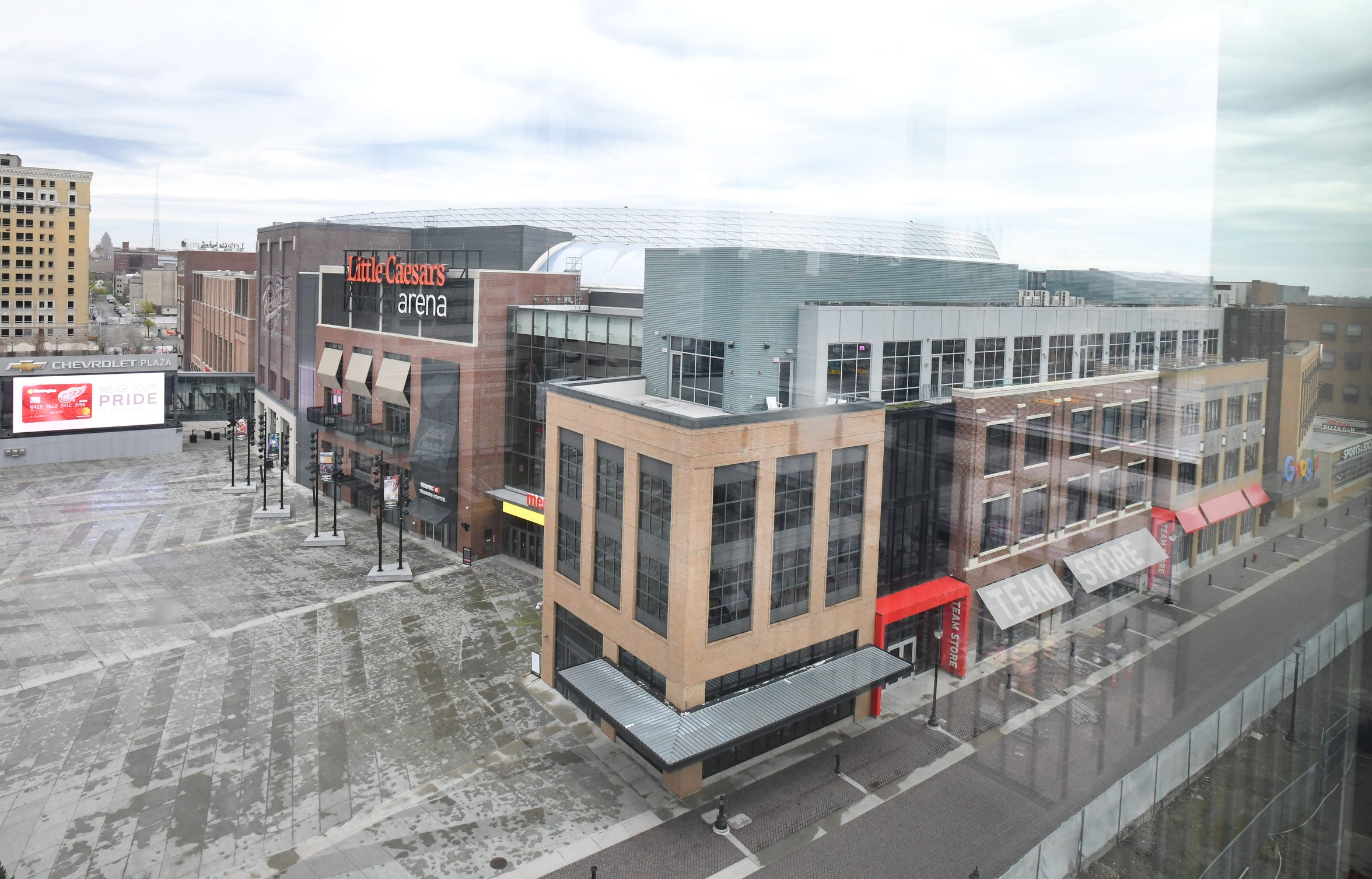 Shot of Little Caesars Arena from parking garage along Henry Street.