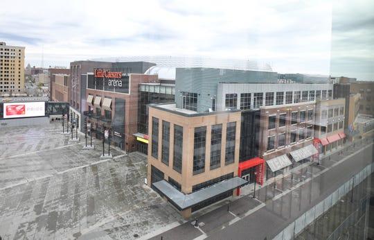Shot of Little Caesars Arena from parking garage along Henry Street.