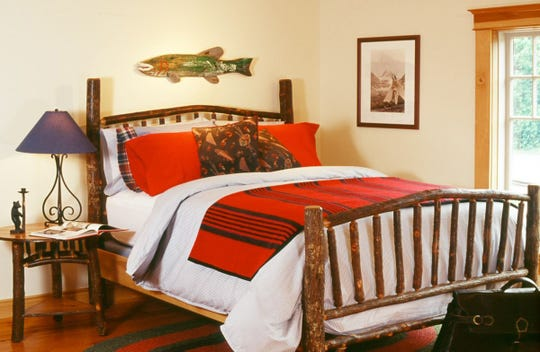 A wooden bed from Old Hickory through Fenton Home Furnishings is just right in a cottage or cabin.