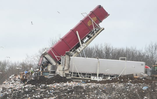 Trucks dump solid waste at Pine Tree Acres Landfill in Lenox Township.
