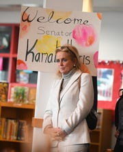 U.S. Representative Debbie Dingell listens as U.S. Senator Kamala Harris reads a story to Dearborn 4th graders during a visit to Miller Elementary School.