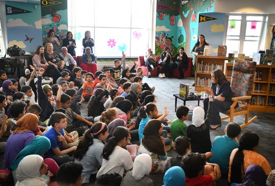 U.S. Sen. Kamala Harris chats with fourth graders during a campaign visit to Miller Elementary School in Dearborn Monday.