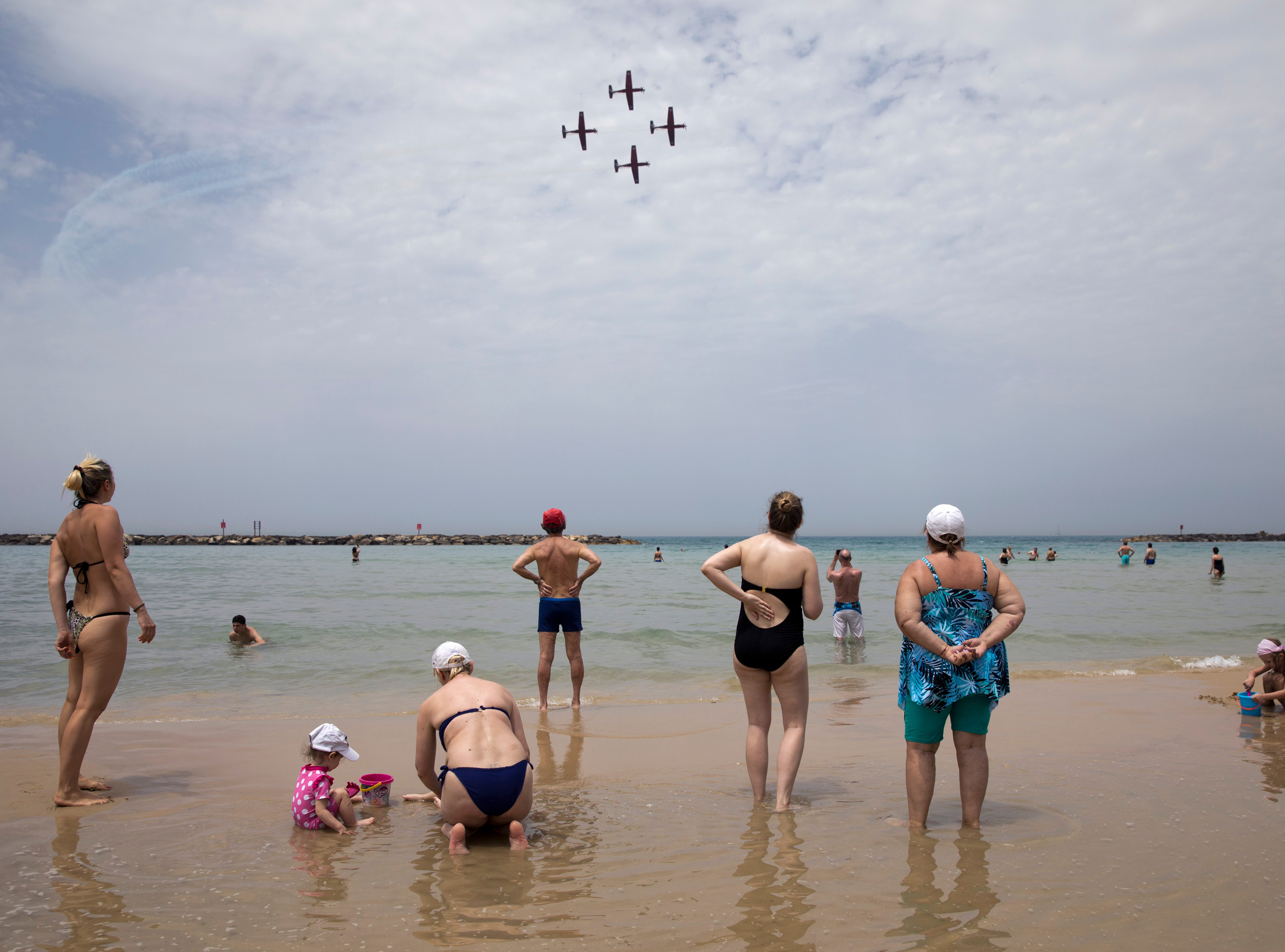 Israeli Air Force aircrafts fly over the coastline during training for upcoming Israel's 71st Independence day celebrations, in Tel Aviv, Israel, Monday, May 6, 2019. Israel will celebrate the 71st anniversary of the founding of the state beginning at sundown Wednesday through to Thursday.