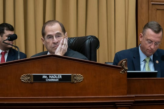 House Judiciary Committee Chair Jerrold Nadler, D-N.Y., joined at right by Rep. Doug Collins, R-Georgia, the ranking member, waits to start a hearing on the Mueller report without witness Attorney General William Barr who refused to appear on Capitol Hill in Washington, Thursday, May 2, 2019.