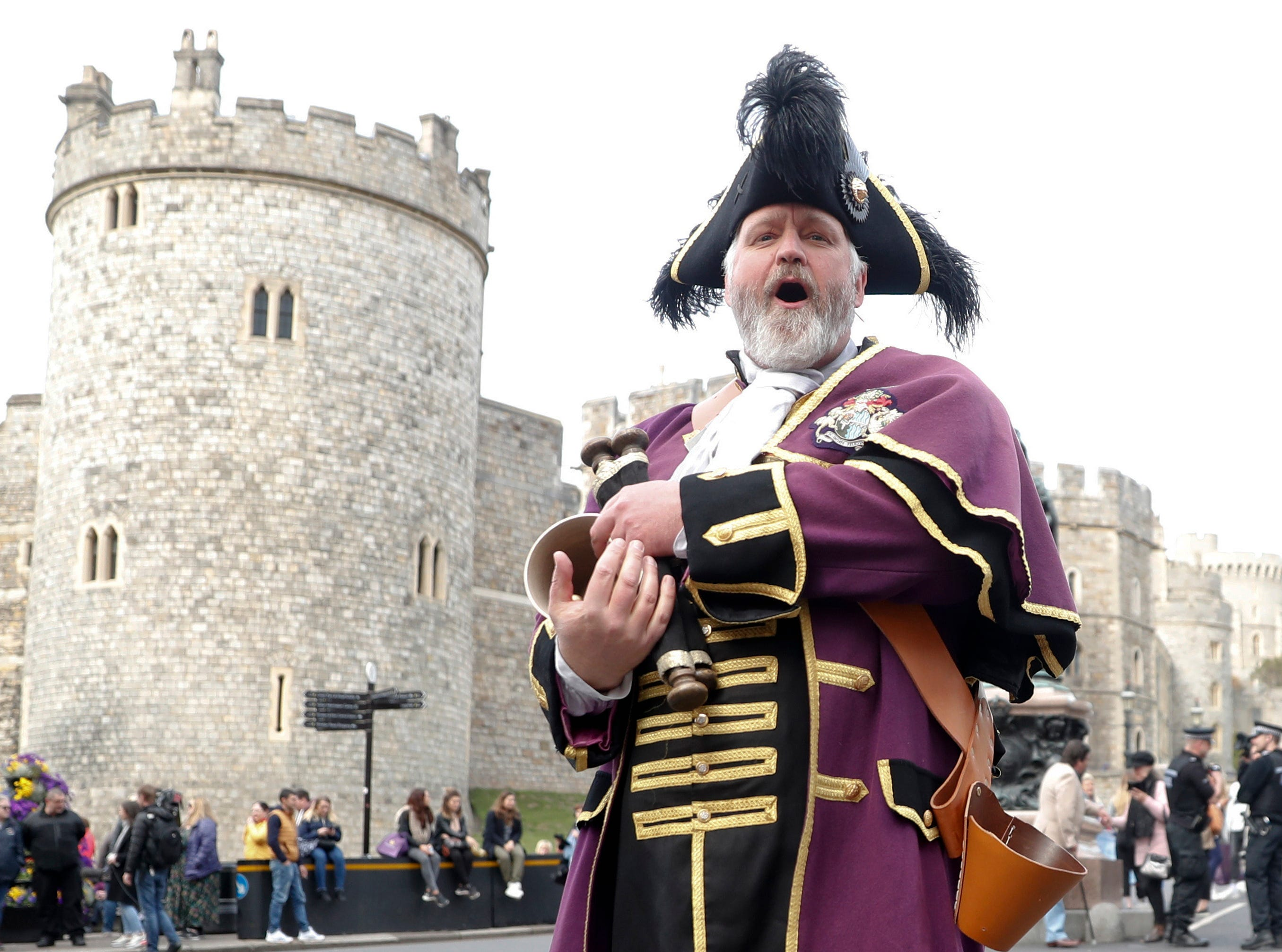 Royal Borough of Windsor and Maidenhead official Town Crier Chris Brown announces the news of the birth of a baby boy to Prince Harry and his wife Meghan, Duchess of Sussex, outside Windsor Castle in Windsor, England, Monday.