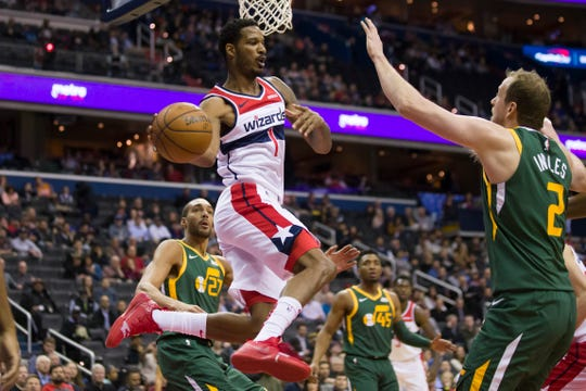 Washington Wizards forward Trevor Ariza posted 12.5 points, 5.4 rebounds and 3.7 assists, while hitting 33 percent on 3-pointers this past season with the Suns and Wizards.