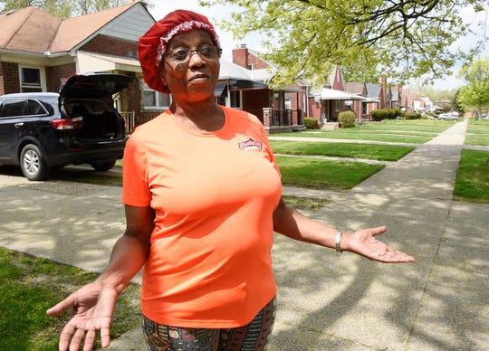 Debra Hornbuckle, 67, of Detroit talks about the dimmed street lights on Marlowe Street.