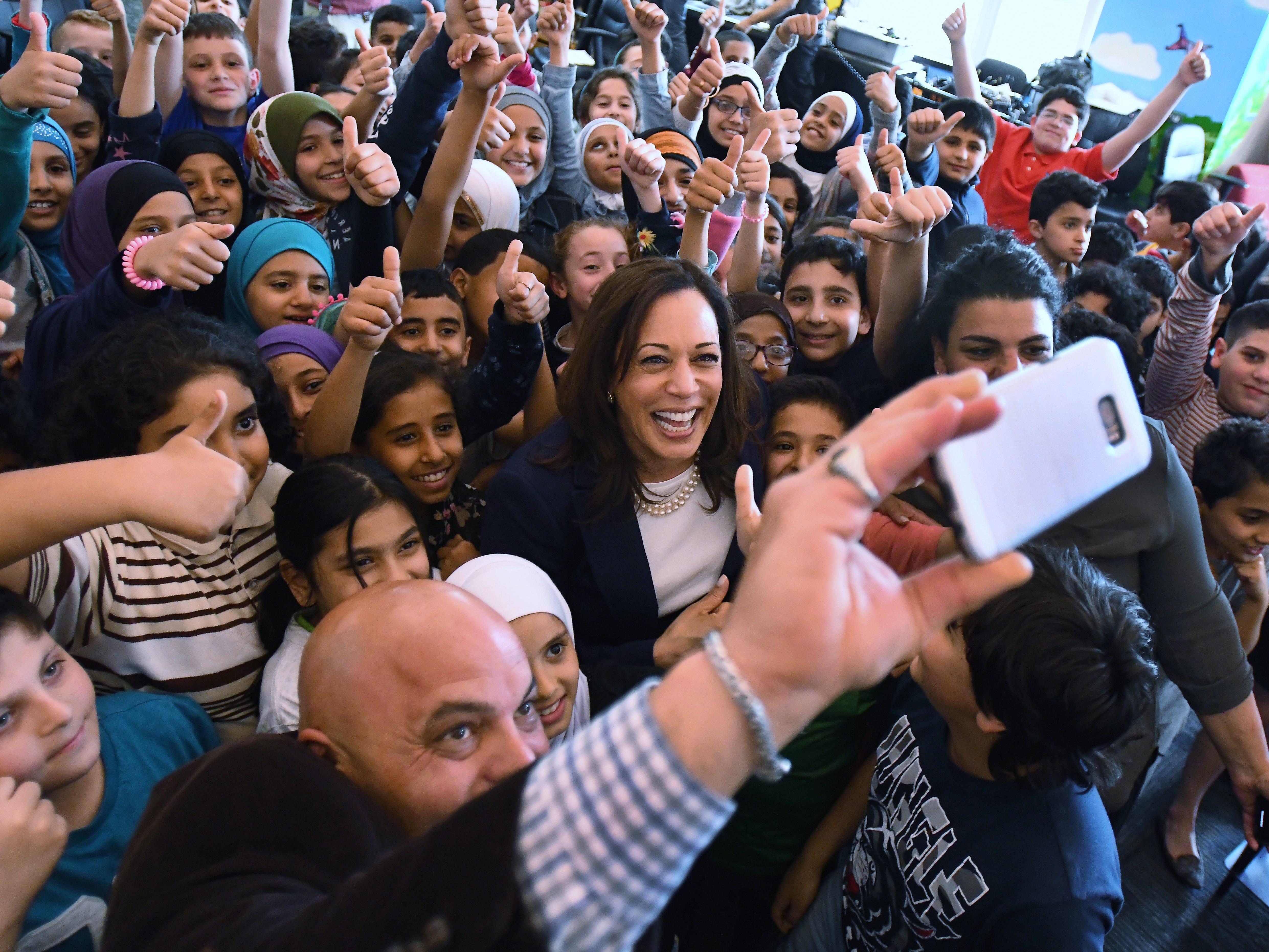 Miller Elementary principal Radwan Awada takes a 'selfie' with U.S. Senator Kamala Harris and Dearborn 4th graders at Miller Elementary School.