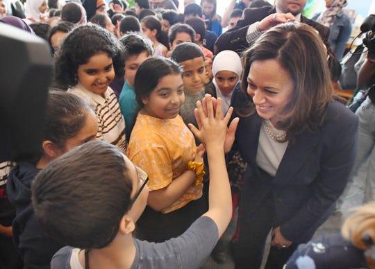 U.S. Sen. Kamala Harris high fives a Dearborn 4th grader at Miller Elementary School.