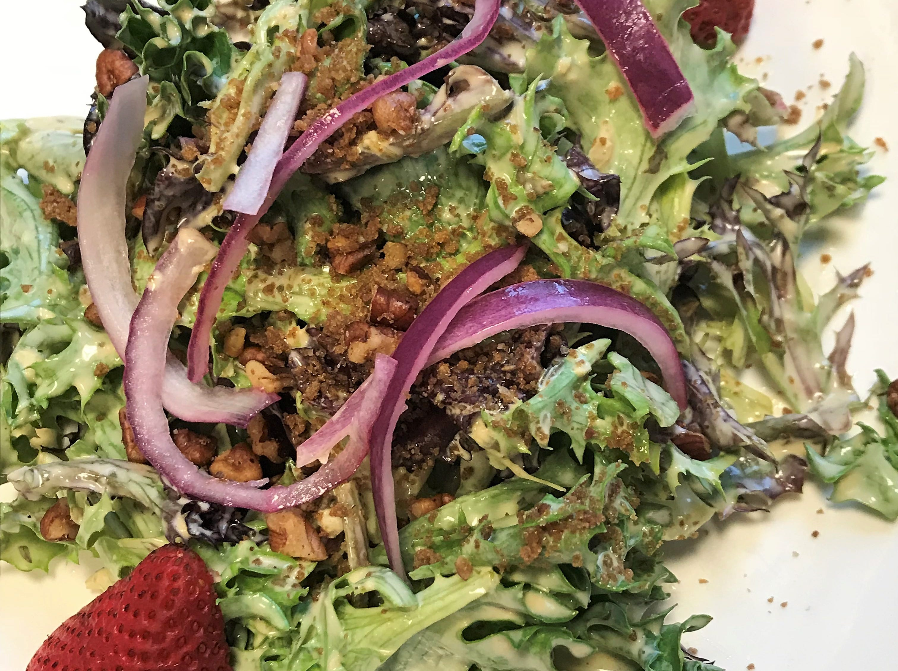 Light greens salad with strawberries, candied pecans and red onions at Amy's on Franklin.