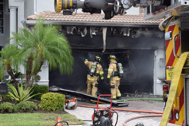An afternoon fire was contained to the garage ina 4,300-square-foot San Carlos Park home Monday.