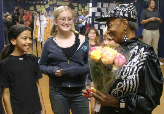 Norma Miller, former jazz dancer and performer, interacts with students of a summer camp at Fort Myers' Florida Repertory Theater in 2005.