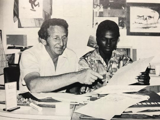 Elmer Tremont meets with Cypress Lake High School basketball player Alphonso Douglas as they celebrate postseason honors in the late 1970s.